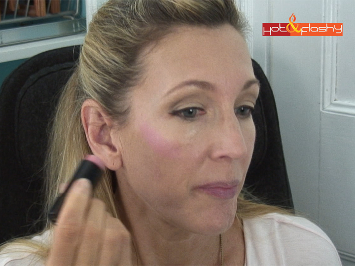 Apply cream blush to the highest point of cheek bones from below the eye to the ear and blend with a stippling brush.